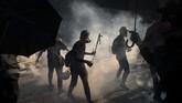 Pemimpin Hong Kong, Carrie Lam melarang penggunaan masker saat demonstrasi. Larangan berlaku sejak Sabtu (5/10). (AP/Felipe Dana)
