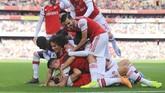 David Luiz merayakan gol yang ia cetak ke gawang Bournemouth. Gol David Luiz mengantar Arsenal menang 1-0. (AP Photo/Leila Coker)