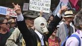 Demonstran 'Pemberontak Kepunahan' (Extinction Rebellion) di seluruh Australia dan Selandia Baru mendesak pemerintah segera bertindak guna mengatasi perubahan iklim. (Photo by PETER PARKS / AFP)