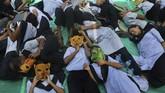 Sejumlah pelajar di Mumbai, India turut melakukan aksi unjuk rasa menentang perubahan iklim. (AP Photo/Rafiq Maqbool)