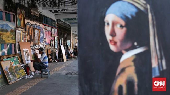 Satu lukisan atau sketsa wajah membutuhkan waktu sekitar satu minggu. Jika dikejar waktu, lukisan bisa selesai lima hari. (CNNIndonesia/Safir Makki)