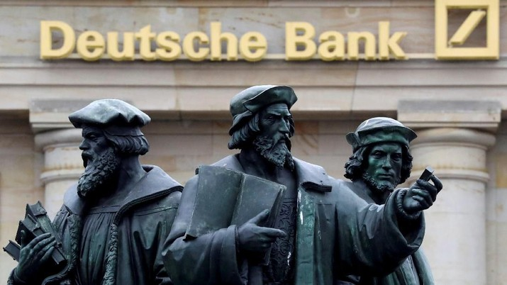 FILE PHOTO: A statue is pictured next to the logo of Germany's Deutsche Bank in Frankfurt, Germany, September 30, 2016. REUTERS/Kai Pfaffenbach/File Photo