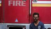 Kebakaran itu sudah menghanguskan 260 kilometer persegi lahan dan 40 rumah. Bencana itu juga menyebabkan hampir 200 ribu penduduk dievakuasi. (AP Photo/Ringo H.W. Chiu)