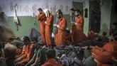 Beberapa milisi ISIS dari luar Suriah dan Irak yang dipenjara oleh pasukan Kurdi merajuk ingin kembali ke negara asal. (FADEL SENNA/AFP)