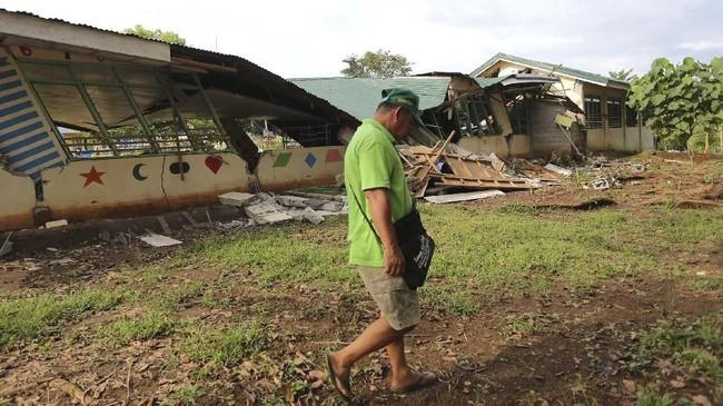 Dua pekan lalu, gempa juga mengguncang wilayah Mindanao. Dalam kejadian itu lima orang meninggal dan puluhan bangunan rusak.(Photo by Manman Dejeto / AFP)