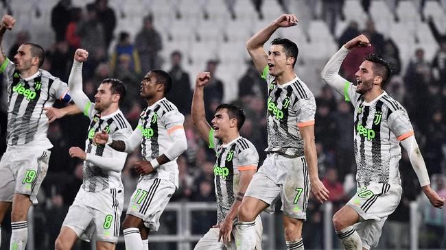 Kemenangan atas Genoa membuat Juventus kembali memimpin klasemen sementara Liga Italia dengan 26 poin, unggul satu poin atas Inter Milan. (MARCO BERTORELLO / AFP)