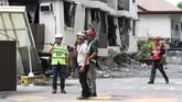 Sebanyak 395 orang terluka dalam kejadian itu dan 2,700 bangunan dan rumah rusak.(AP Photo)