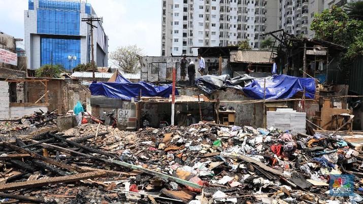 Kampung Cawang terimpit pembangunan apartemen baru di wilayah tersebut.