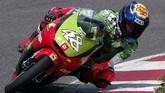 Jorge Lorenzo mengawali karier di dunia balap dengan turun di kelas 125cc bersama Derbi Racing Team. Lorenzo menghabiskan tiga musim di sana. (Photo by LLUIS GENE / AFP)
