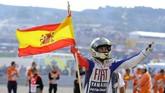 Jorge Lorenzo akhirnya mendapatkan titel juara dunia di kelas MotoGP untuk pertama kali dalam kariernya di 2010.(Photo by JOSE JORDAN / AFP)