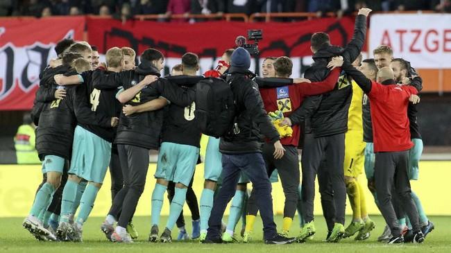 Timnas Austria lolos ke Piala Eropa 2020 dengan status runner-up Grup G di bawah Polandia. (AP Photo/Ronald Zak)