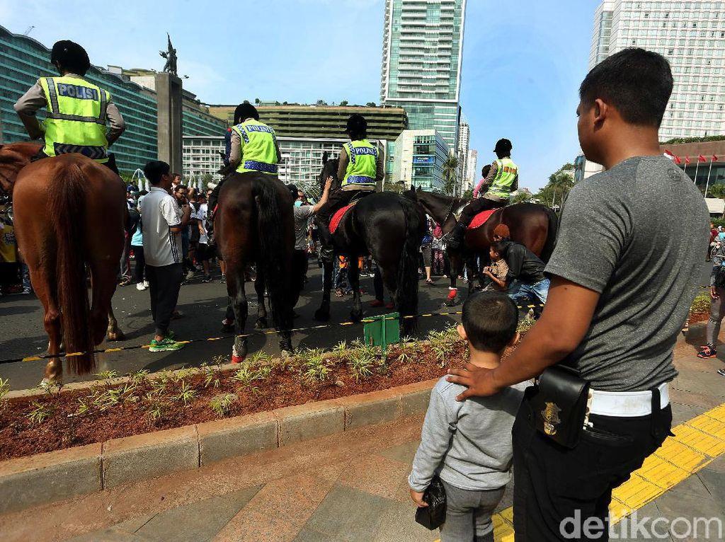Empat polisi berkuda yang diterjunkan di acara car free day berasal dari Direktorat Polisi Satwa Mabes Polri.