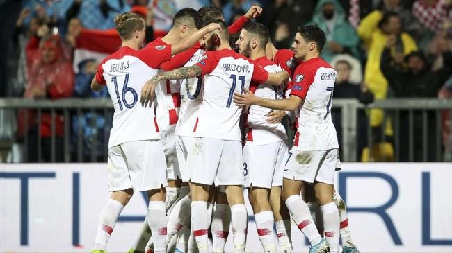Timnas Kroasia memastikan juara Grup E berkat kemenangan 3-1 atas Slovakia di Stadion Rujevica, Rijeka. (AP Photo/Daniel Kasap)