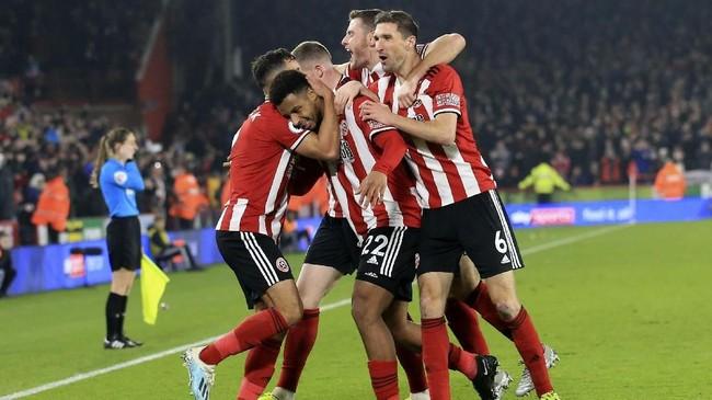 Sheffield United bermain luar biasa di babak pertama melawan Manchester United walau akhirnya gagal menjaga konsistensi selama 90 menit dan membuat skor pertandingan jadi 3-3. (AP Photo/Jon Super)