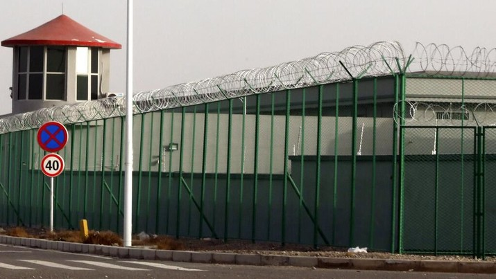 FILE.- In this Monday, Dec. 3, 2018, file photo, a guard tower and barbed wire fences are seen around a section of the Artux City Vocational Skills Education Training Service Center in Artux in western China's Xinjiang region. This is one of a growing number of internment camps in the Xinjiang region, where by some estimates over 1 million Muslims have been detained, forced to give up their language and their religion and subject to political indoctrination. Confidential documents, leaked to a consortium of news organizations, lay out the Chinese government's deliberate strategy to lock up ethnic minorities to rewire their thoughts and even the language they speak. One of the documents says that internment camps – such as the one in Artux – are to install guard towers, as well as other security measures to