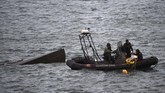 Sebuah kapal selam tak dikenal yang ditangkap di Kota Cangas, Galicia, Spanyol, ternyata memuat narkotika jenis kokain sebanyak tiga ton. Nilainya ditaksir mencapai US$100 juta (sekitar Rp1,4 triliun). (Lalo R. VILLAR / AFP)