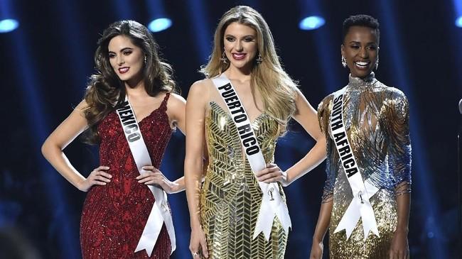 Gelar ini sekaligus membuktikan bahwa kecantikan tak mengenal warna kulit. Tunzi jadi Miss Universe yang memiliki warna kulit gelap setelah Leila Lopez dari Angola pada 2011 lalu. (Paras Griffin/Getty Images/AFP)