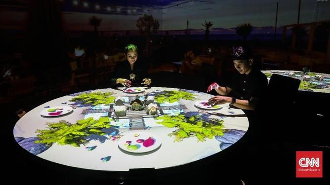 Pengalaman baru menikmati makan di area virtual dining di Trans Studio Bali ditemani instrumen musik Bali selama 15 menit. (CNNIndonesia/Safir Makki)
