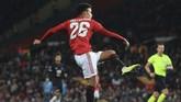 Kemenangan atas AZ membuat Manchester United lolos ke babak 32 besar Liga Europa sebagai juara Grup L. (Lindsey Parnaby / AFP)