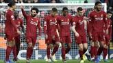 Mohamed Salah merayakan gol pertama Liverpool saat melawan Watford. Skor 1-0 untuk The Reds bertahan hingga akhir babak pertama. (AP Photo/Rui Vieira)