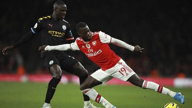 Manchester City menambah penderitaan Arsenal di Liga Inggris dengan menang 3-0 atas The Gunners di Stadion Emirates. Arsenal kini dua kali menelan kekalahan dalam tiga pertandingan terakhir Liga Inggris. (AP Photo/Ian Walton)