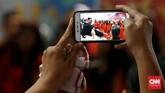 """""""Christmas Carol"""" menjadi salah satu bagian dari rangkaian perayaan Natal yang diinisiasi oleh Pemprov DKI Jakarta bertajuk Christmas in Jakarta. (CNN Indonesia/Andry Novelino)"""
