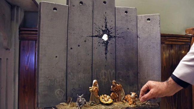 Karya Terbaru Banksy, Yesus Lahir di Tembok Perbatasan Israel