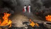 Demonstrasi di KotaBasra, Irak, pada 17November 2019. (Photo by Hussein FALEH / AFP)