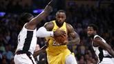 Los Angeles Lakers yang jadi pemuncak klasemen wilayah barat menghadapi Los Angeles Clippers di Staples Center. (AP Photo/Ringo H.W. Chiu)