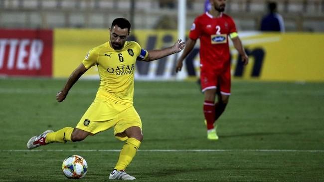 Spanyol juga kehilangan salah satu pemain terbaiknya, Xavi Hernandez, yang pensiun pada Mei 2019 bersama Al Sadd. Xavi kemudian menjadi pelatih Al Sadd. (ATTA KENARE / AFP)