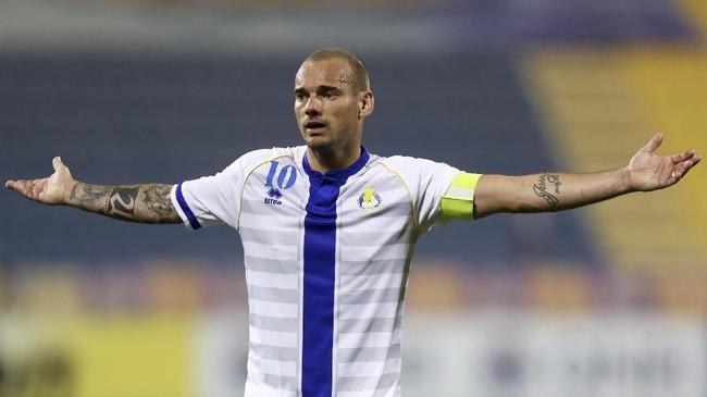 Salah satu pemain dari generasi emas Belanda Wesley Sneijder pensiun pada 12 Agustus 2019 dan terakhir memperkuat Al-Gharafa di Qatar. (KARIM JAAFAR / AFP)