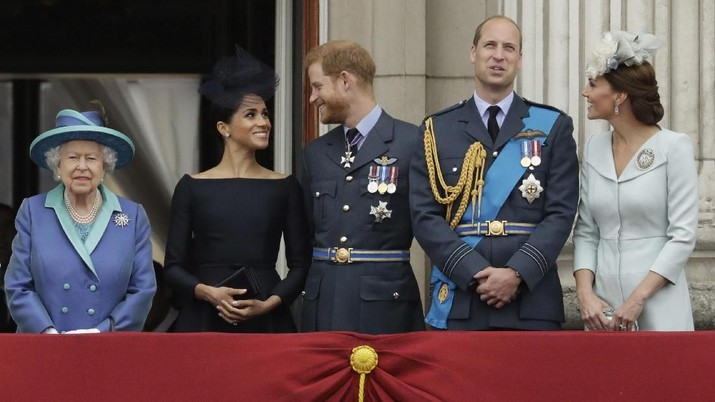 FILE - In this Tuesday, July 10, 2018 file photo Britain's Queen Elizabeth II, and from left, Meghan the Duchess of Sussex, Prince Harry, Prince William and Kate the Duchess of Cambridge watch a flypast of Royal Air Force aircraft pass over Buckingham Palace in London. In a stunning declaration, Britain's Prince Harry and his wife, Meghan, said they are planning