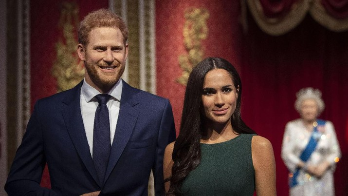 The figures of Britain's Prince Harry and Meghan, Duchess of Sussex, left, in their original positions next to Queen Elizabeth II, Prince Philip and Prince William and Kate, Duchess of Cambridge, at Madame Tussauds in London, Thursday Jan. 9, 2020. Madame Tussauds moved its figures of Prince Harry and Meghan, Duchess of Sussex from its Royal Family set to elsewhere in the attraction. (Victoria Jones/PA via AP)