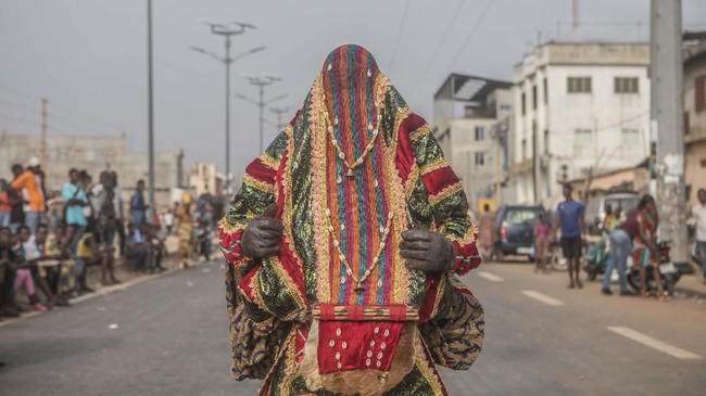 Voodoo adalah jalan kehidupan, yang juga berperan dalam perkembangan budaya, filosofi, bahasa, seni, tari, musik, dan medis. (Yanick Folly/AFP)