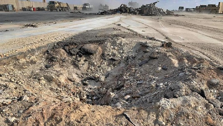Iranian bombing caused a crater at Ain al-Asad air base in Anbar, Iraq, Monday, Jan. 13, 2020. Ain al-Asad air base was struck by a barrage of Iranian missiles last Wednesday, in retaliation for the U.S. drone strike that killed atop Iranian commander, Gen. Qassem Soleimani, whose killing raised fears of a wider war in the Middle East. (AP Photo/Ali Abdul Hassan)