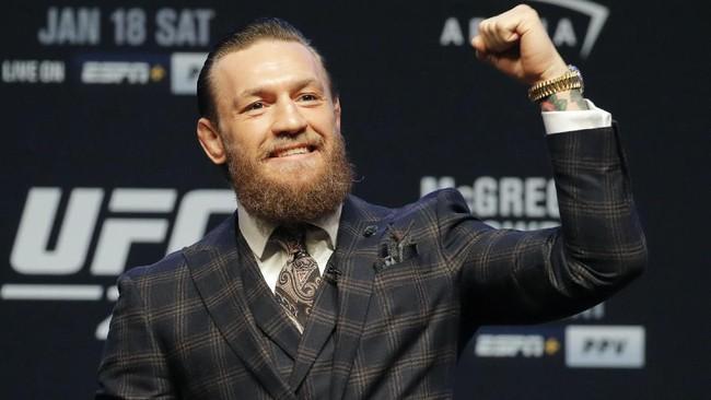 Conor McGregor menunjukkan sikap yang berbeda dalam konferensi pers UFC 246. McGregor lebih kalem dan tidak mengeluarkan kata-kata kotor ke Donald Cerrone. (Kirill KUDRYAVTSEV / AFP)