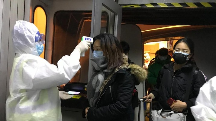 Pengecekkan Virus Corona di Berbagai Bandara. (AP Photo/Emily Wang)