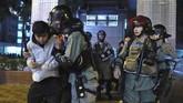 Untuk meminimalisir penyebaran virus corona, warga meminta pemerintah menutup perbatasan Hong Kong dan China. (AP Photo/Vincent Yu)