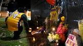 Seorang fan Christina Espinoza menaruh lilin sebagai benturk penghormatan untuk Kobe Bryant yang meninggal akibat kecelakaan helikopter di Calabasas, California. (AP Photo/Kelvin Kuo)