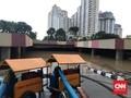 Pagi hingga Petang, Banjir Underpass Kemayoran Belum Surut