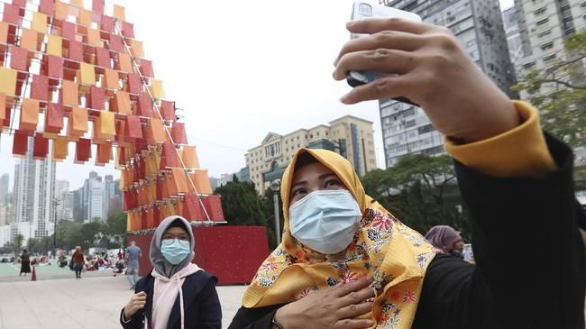 KJRI sudah menyampaikan permintaan ke pemerintah untuk segera mengirim masker bagi WNI di Hong Kong. (AP Photo/Achmad Ibrahim)