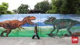 Tidak diketahui siapa yang menginisiasi mural ini. Namun ternyata seni ini membawa perubahan besar di antara penat Jakarta Utara. (CNNIndonesia/Safir Makki)