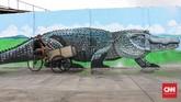 Mural juga dianggap sebagai ekspresi kritik, pernyataan sikap, hingga estetika dan simbol kota. (CNNIndonesia/Safir Makki)