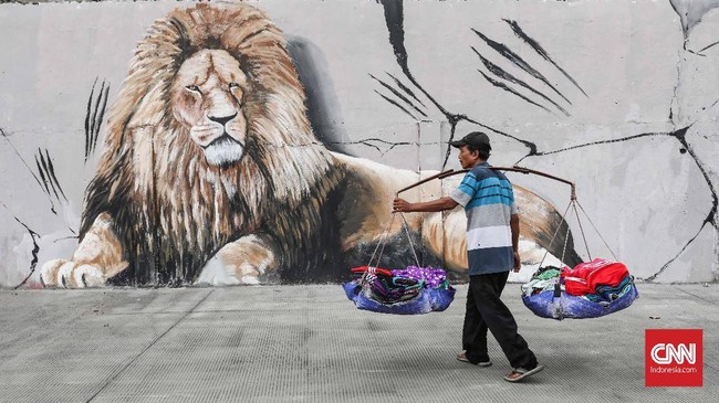 Fungsi mural kini tak hanya menjadi ruang interaktif antara seniman, warga, dan lingkungan. (CNNIndonesia/Safir Makki)