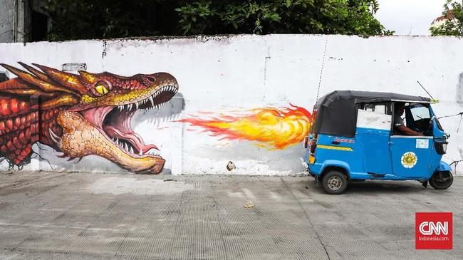 Hari ini, seni mural seolah sudah menjadi identitas baru sebuah kota, seperti gambar-gambar yang menghiasi kawasan Kali Opak, Jakarta Utara. (CNNIndonesia/Safir Makki)