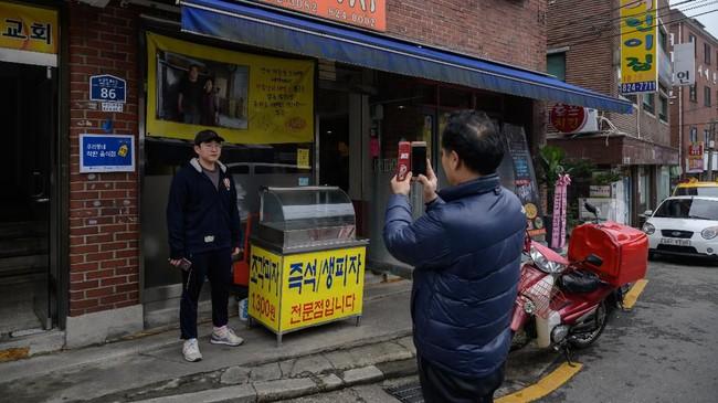 Pemerintah kota telah berupaya memanfaatkan fenomena Parasite, dengan mempromosikan empat lokasi syuting film di situs resmi Badan Pariwisata Seoul. (Ed JONES / AFP)