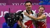 Gabrielle Adcock dan Chris Adcock merupakan pasangan suami-istri asal Inggris yang berkarier sebagai ganda campuran di dunia bulutangkis. (Saeed KHAN / AFP)