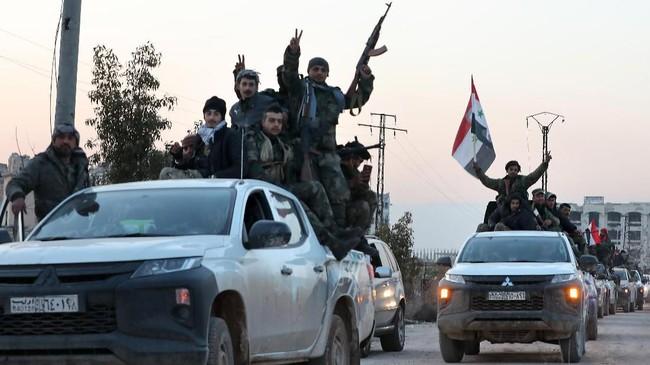 Pasukan Suriah berhasil memukul mundur pemberontak karena dibantu serangan bertubi-tubi oleh pasukan Iran dan Rusia.(Photo by LOUAI BESHARA / AFP)