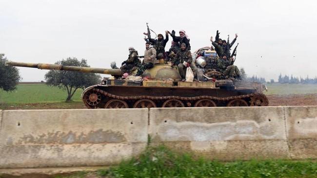 Menurut stasiun televisi Suriah, Al-Ikhbariya, pasukan Suriah saat ini masih terlibat pertempuran dengan pemberontak di sebagian kawasan pedesaan Aleppo.(SANA via AP)