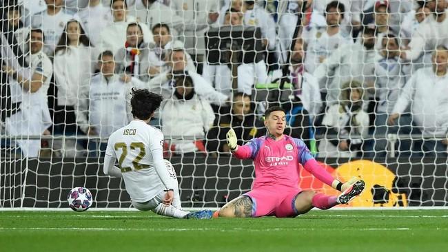 Isco berhasil mencetak gol lebih dulu untuk membawa Real Madrid unggul di menit ke-60. (Photo by OSCAR DEL POZO / AFP)